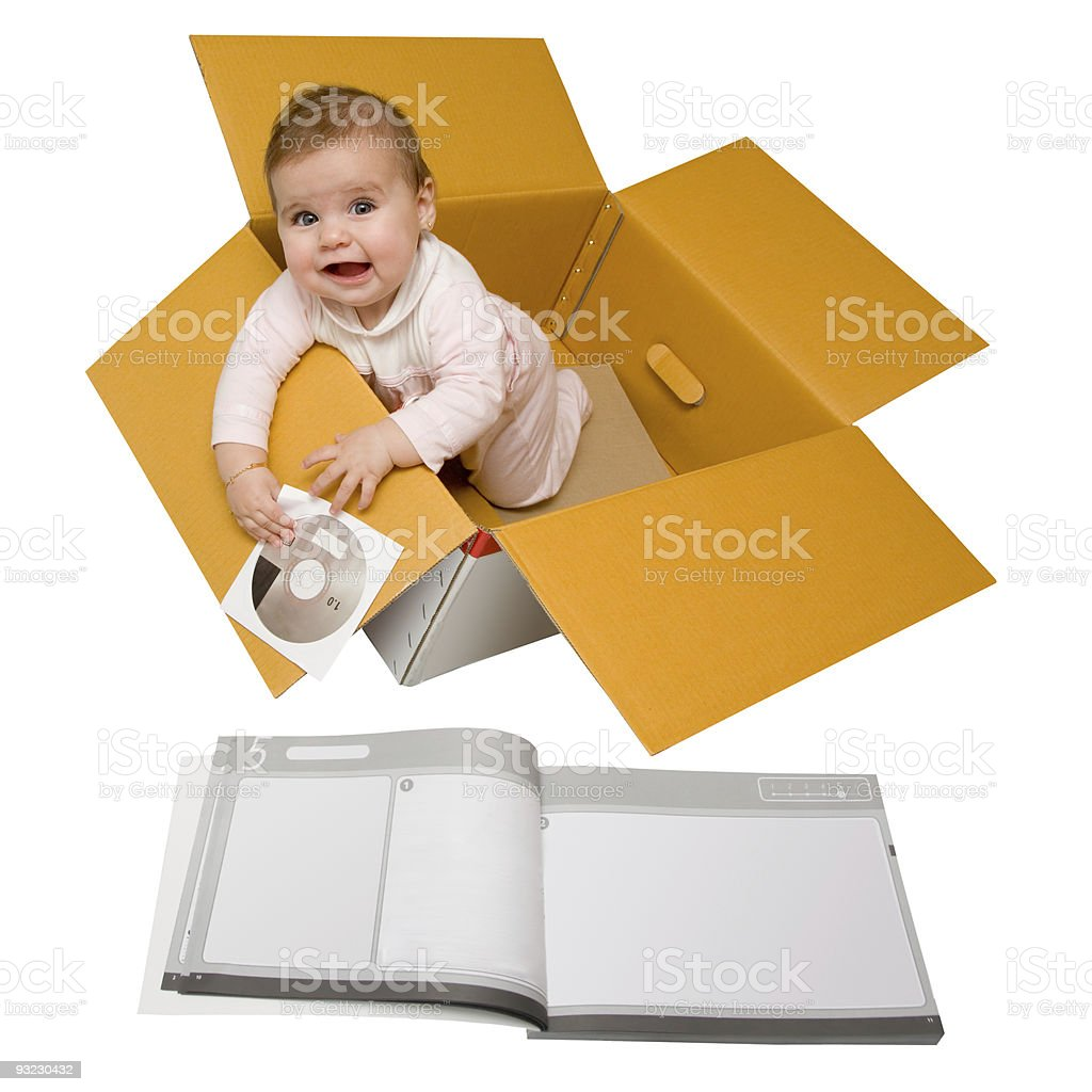 Baby in a box. Delivered with instructions. stock photo