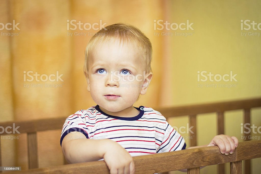 baby in a cot stock photo
