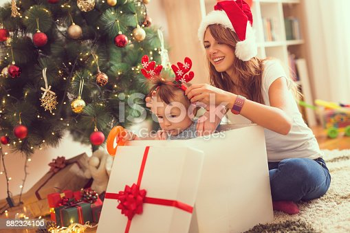 579124316 istock photo Baby in a gift box on a Christmas morning 882324100