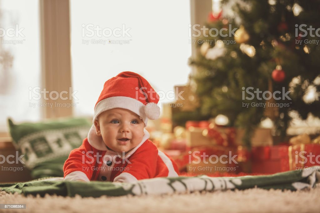 Baby in a Santa Claus costume stock photo