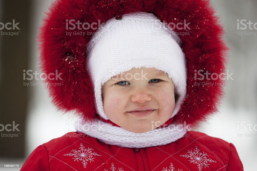 Baby in a winter suit royalty-free stock photo