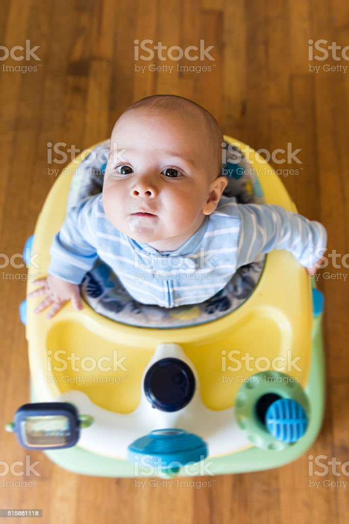 Baby in baby walker stock photo