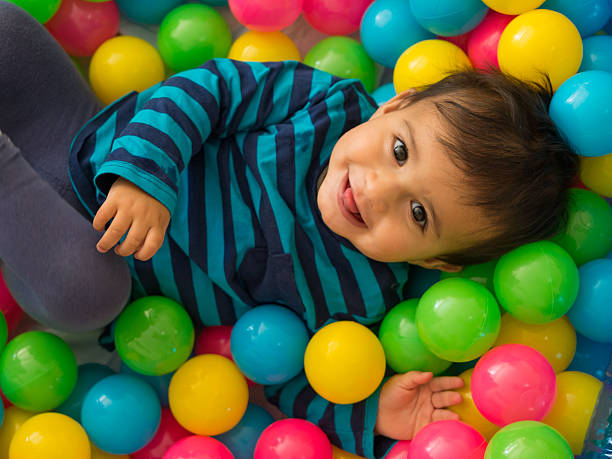 Baby in Ball Pool stock photo