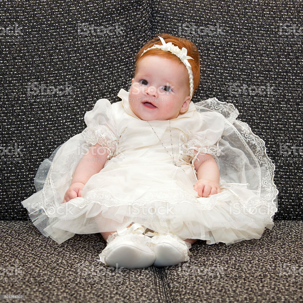 Baby in baptismal clothing stock photo