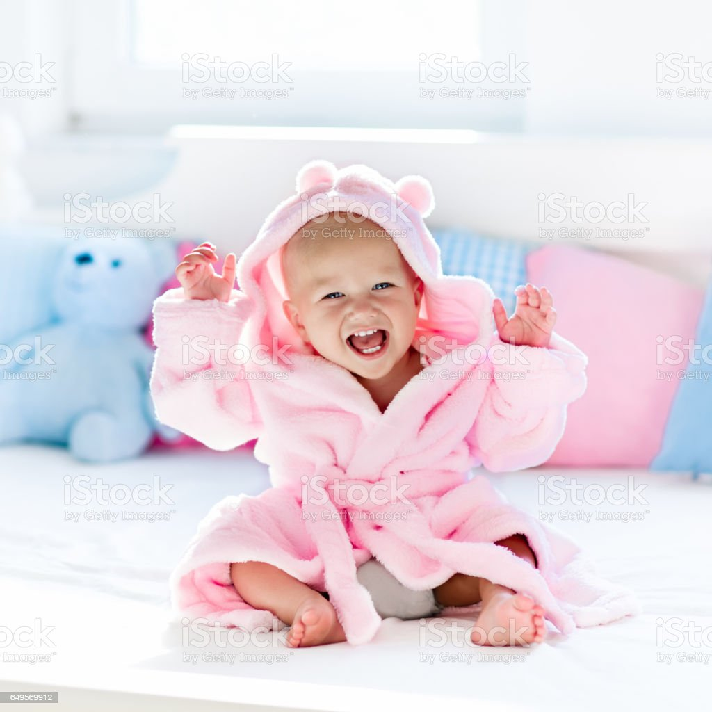 b99eeb4cf Baby In Bathrobe Or Towel After Bath Stock Photo   More Pictures of ...