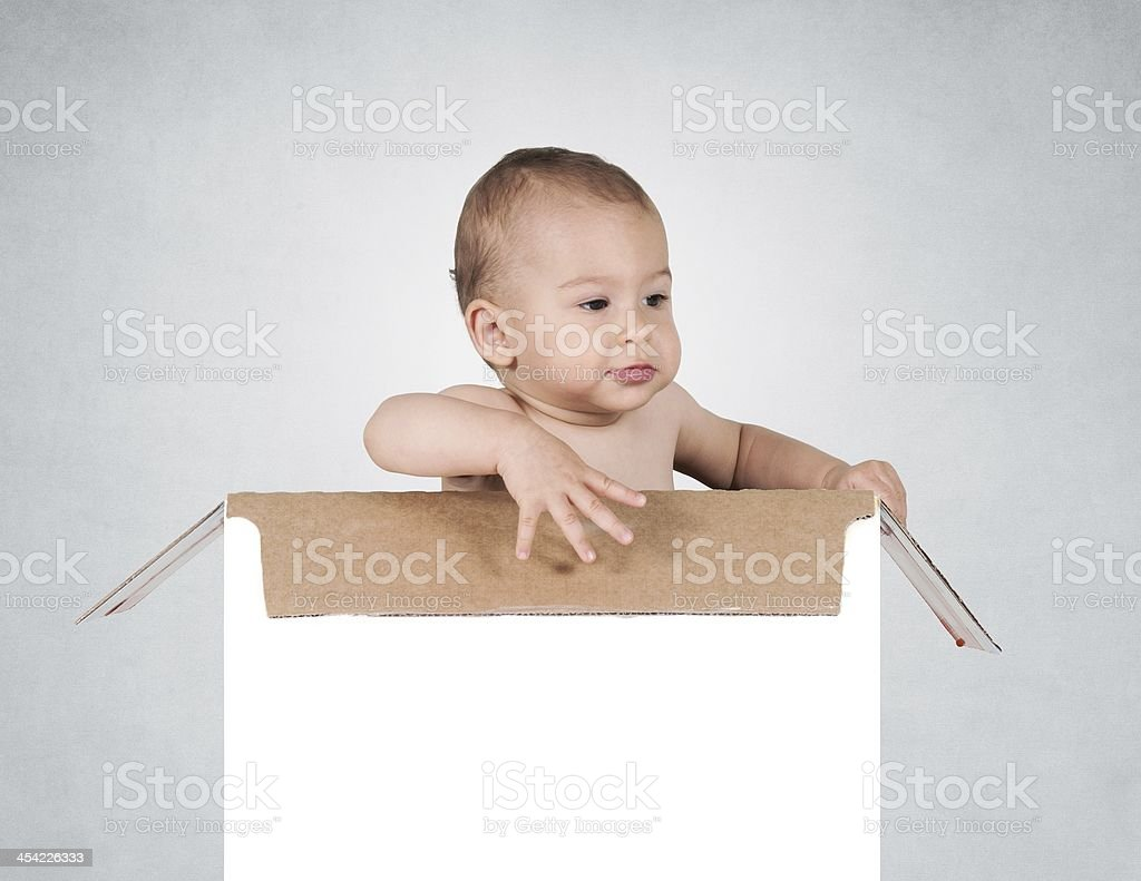 Baby in box stock photo