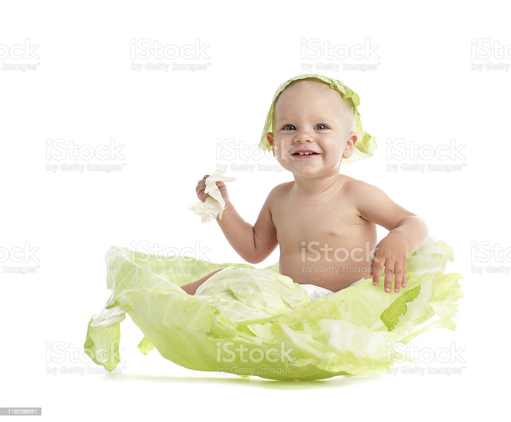Baby in cabbage stock photo