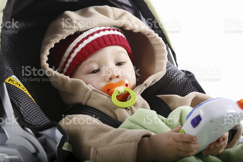 Baby in car seat with toy stock photo