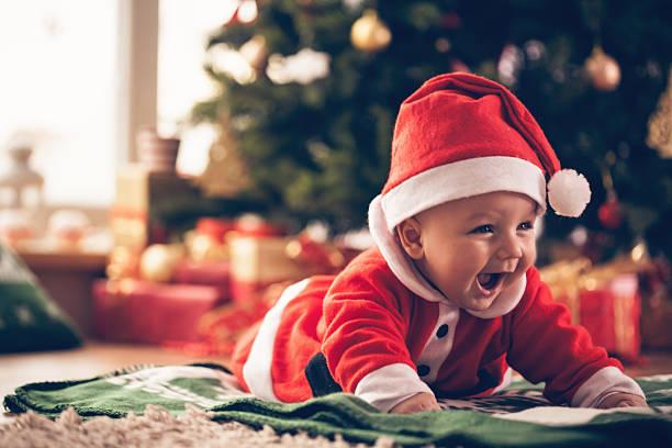 baby in-kostüm - nikolaus kostüm stock-fotos und bilder