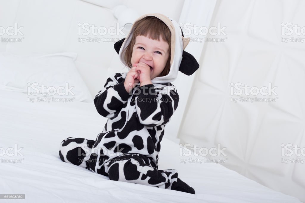 Baby in cow costume stock photo