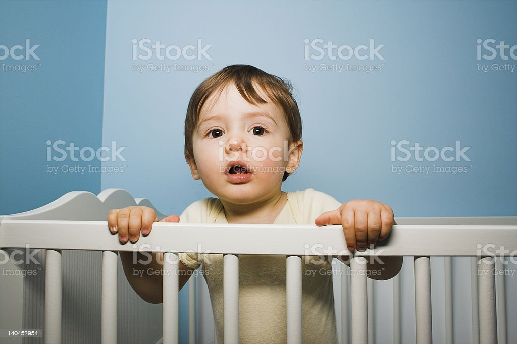 baby in crib stock photo