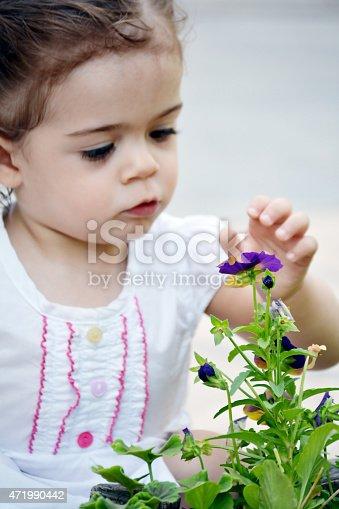 185267233 istock photo baby in garden 471990442