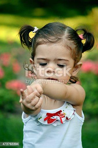 185267233 istock photo baby in garden 473763394