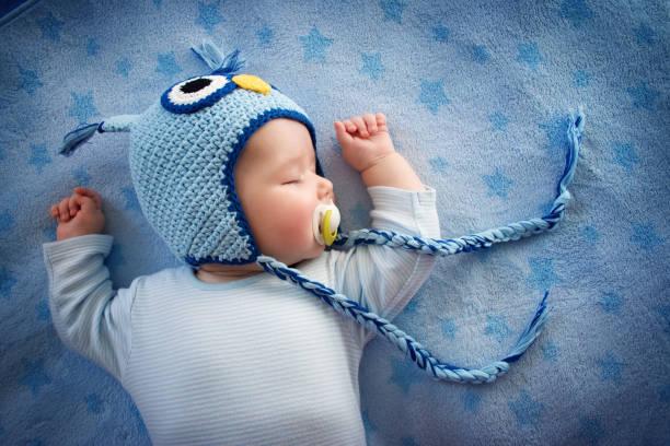 Baby in owl hat sleeping picture id468064416?b=1&k=6&m=468064416&s=612x612&w=0&h=d0gzf fzzjl5xn4moupi1rhpdtph2cb0j nwkqjbhg0=