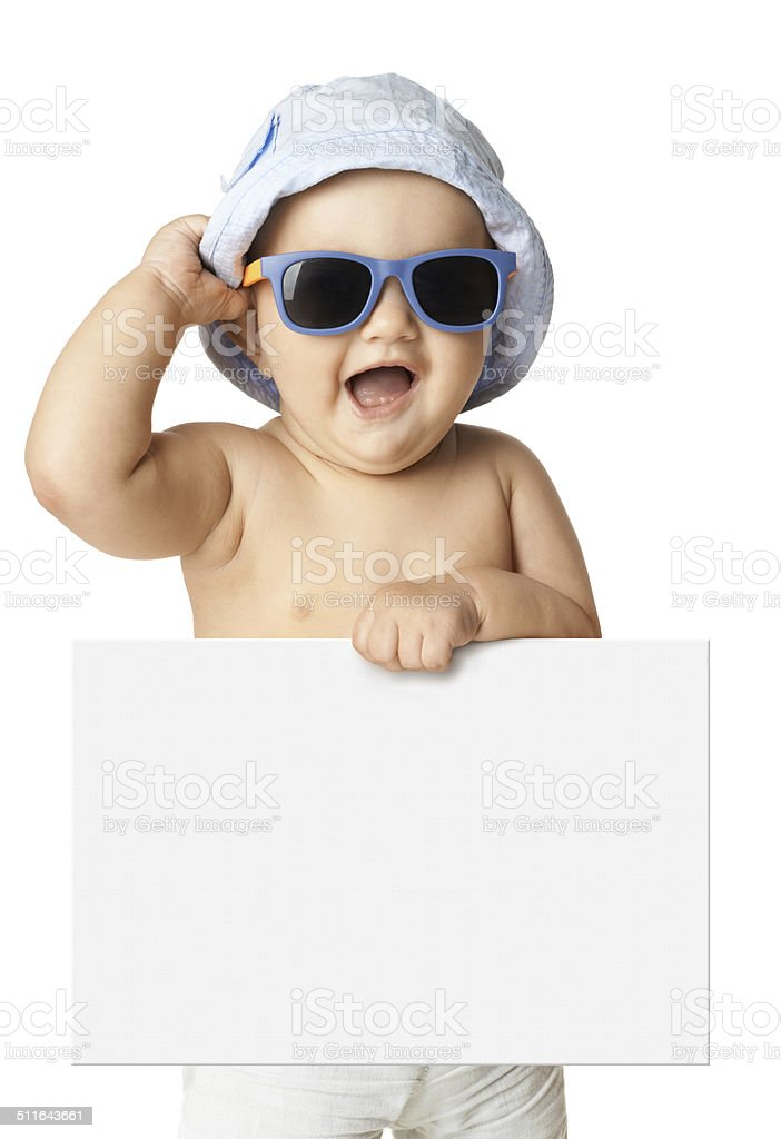 baby in panama and sunglasses holding a banner stock photo