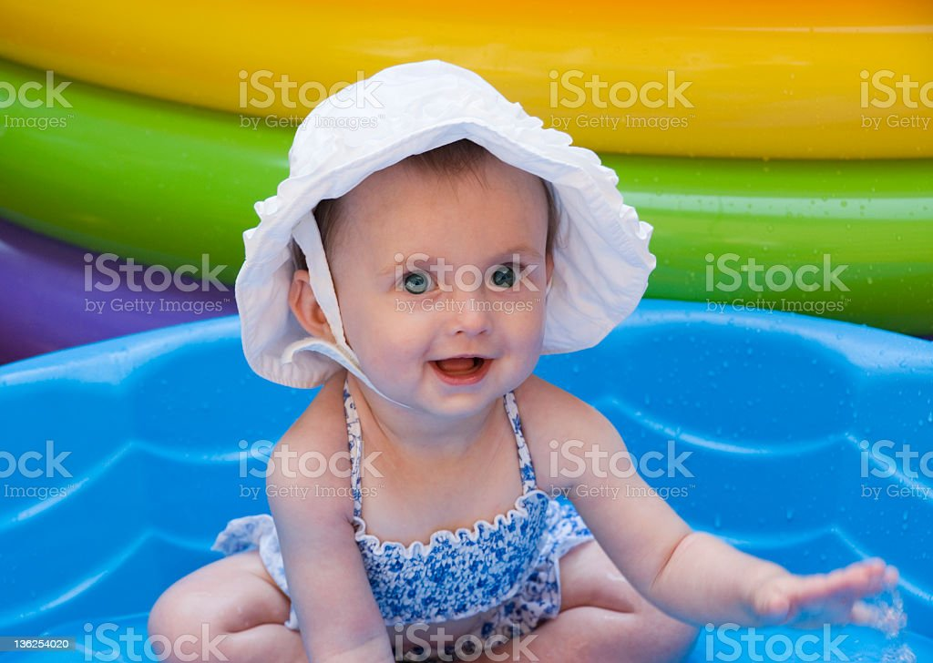 Baby in pool stock photo