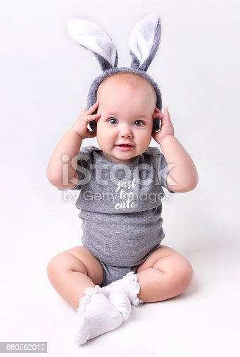 istock Baby in rabbit bunny easter costume on white background. 880562012