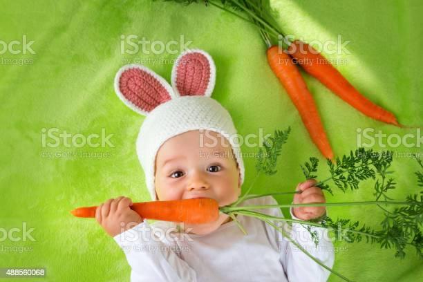 Baby in rabbit hat eating carrot picture id488560068?b=1&k=6&m=488560068&s=612x612&h=ke3urtq ibx23emf kkamvoasv8dkj3u6hygfqgimkg=