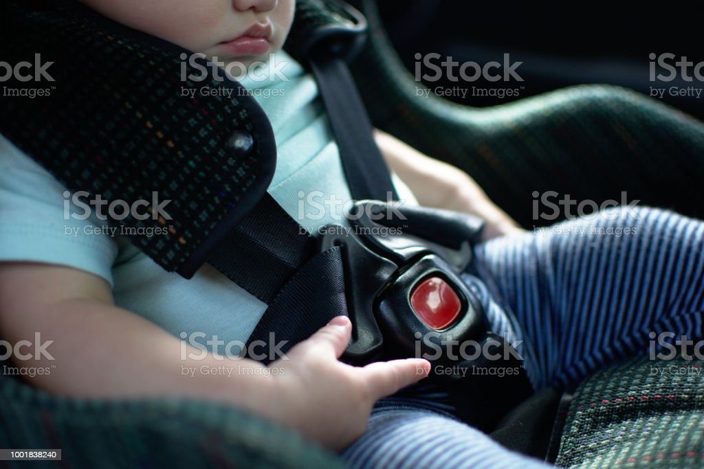 Baby in rear facing car seat  has the safety belt on stock photo