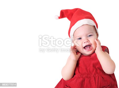 istock Baby in santa hat isolated on white. 883077514