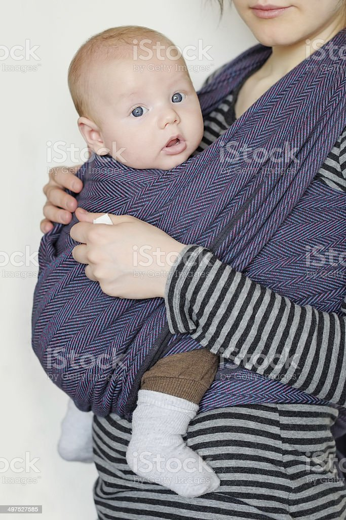 Baby in sling stock photo