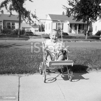 Baby in stroller. Waterloo, Iowa, 1959. Scanned film with grain.