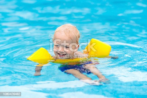 istock Baby in swimming pool. Kids swim. 1080426462