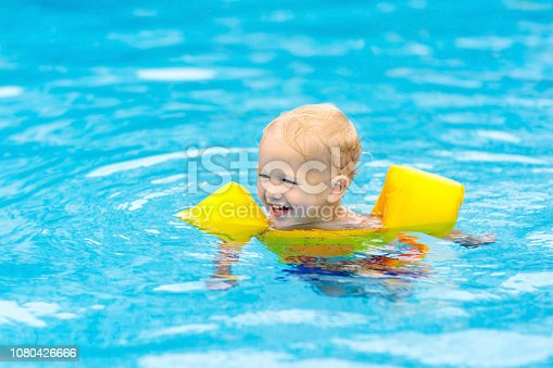 istock Baby in swimming pool. Kids swim. 1080426666