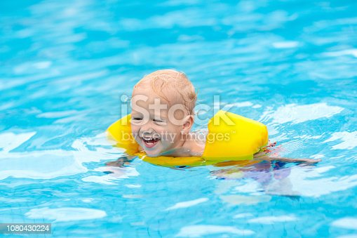 istock Baby in swimming pool. Kids swim. 1080430224