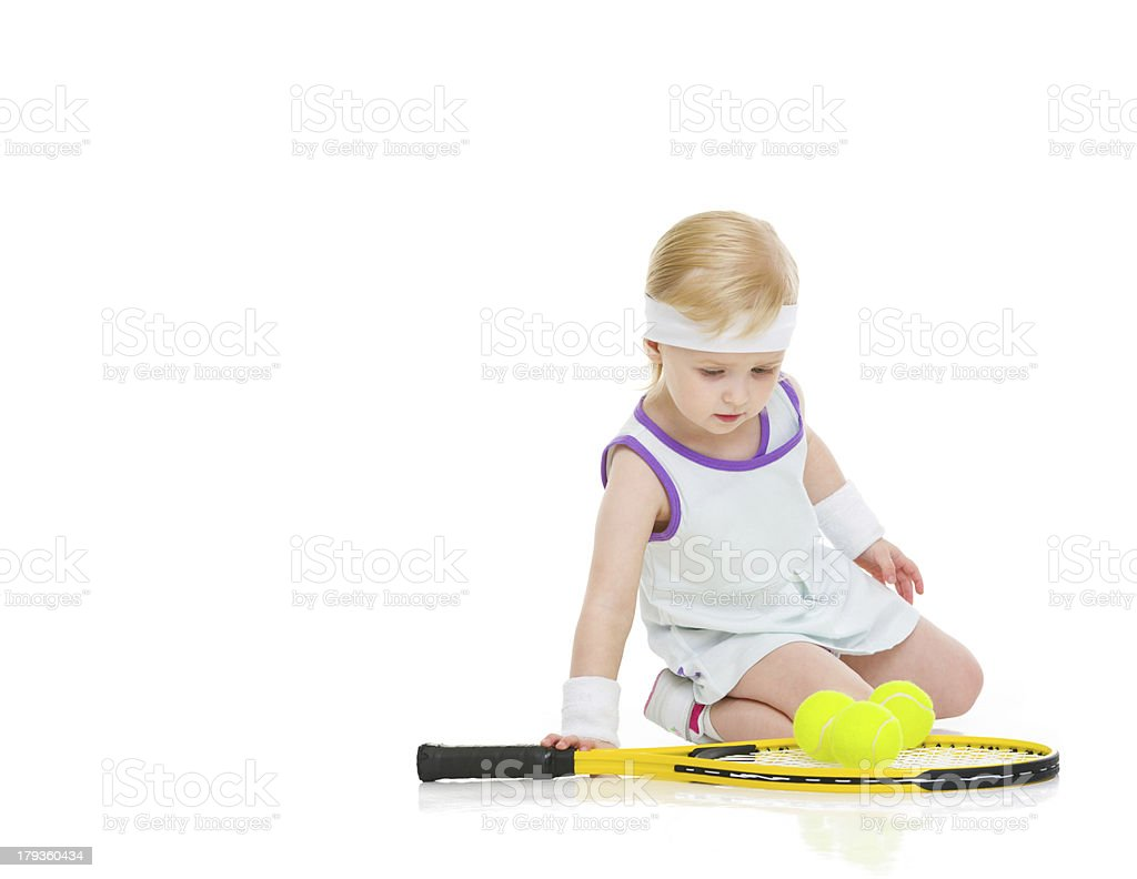 Baby in tennis clothes with racket and balls royalty-free stock photo