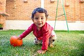 istock Baby in the backyard 1290360101