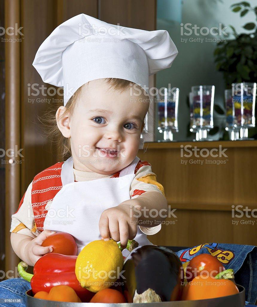 Bébé dans le costume de cuisinier photo libre de droits