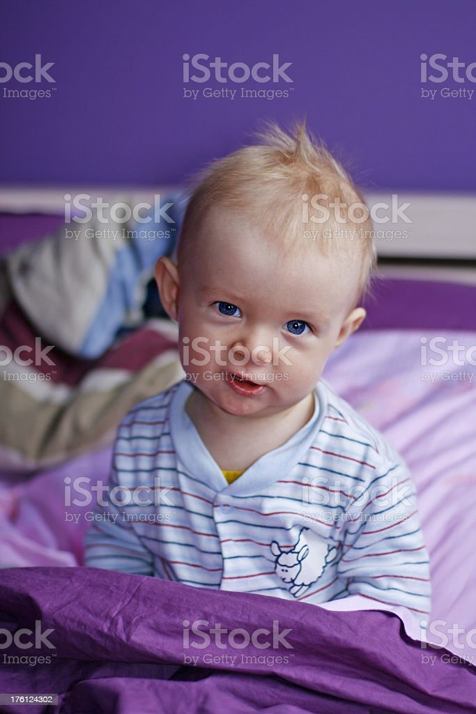Baby in violet bed royalty-free stock photo