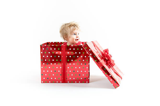 Baby inside red Christmas gift box stock photo