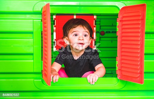 istock baby inside toy house playhouse child look out the window 848692532