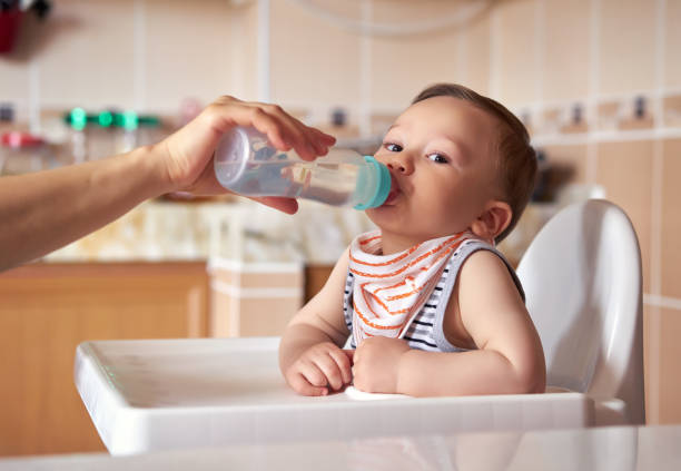 Baby is drinking water stock photo