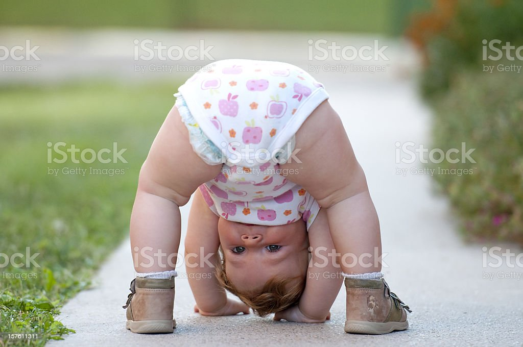 Baby is just playing on the street stock photo