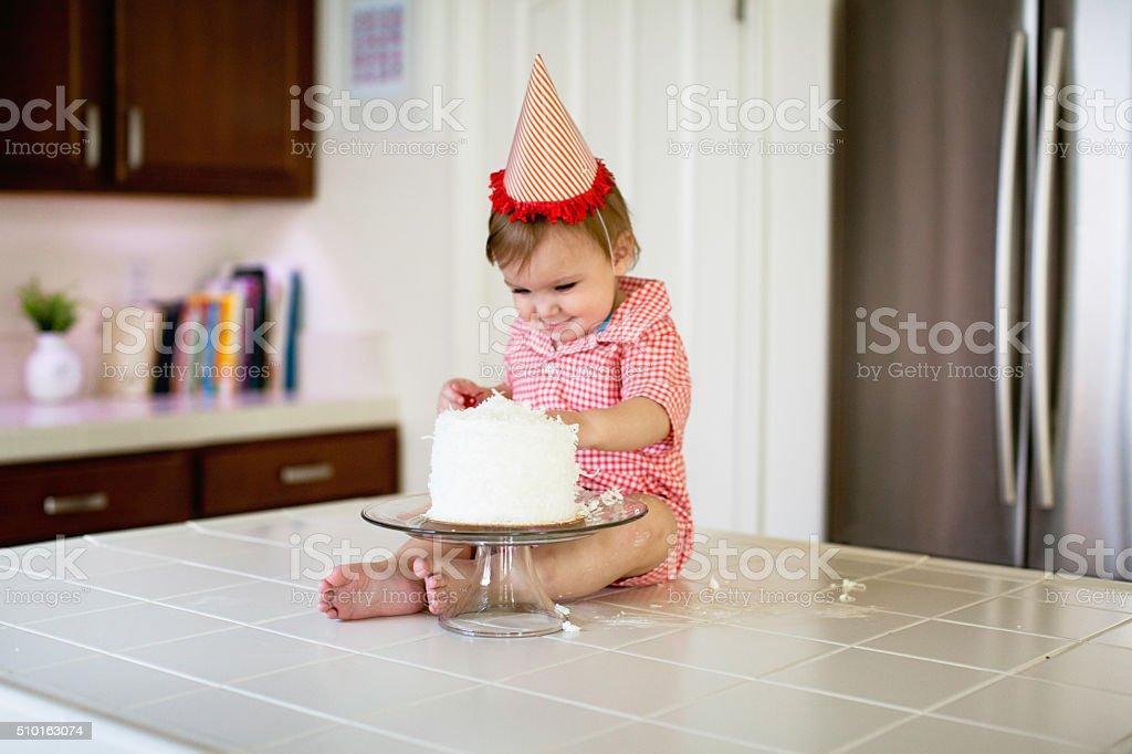Baby is Smashing a Birthday Cake stock photo