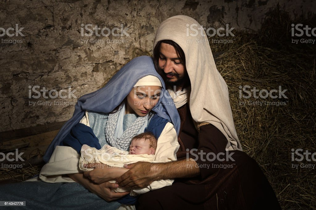 Live Christmas nativity scene in an old barn - Reenactment play with...