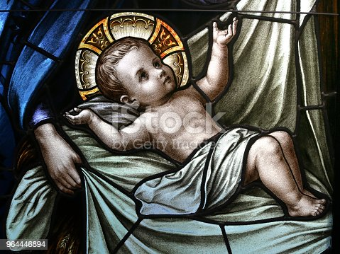Baby Jesus in Swaddling Clothes Stained Glass Window