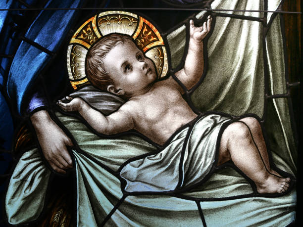 Baby Jesus in Swaddling Clothes Stained Glass Window stock photo