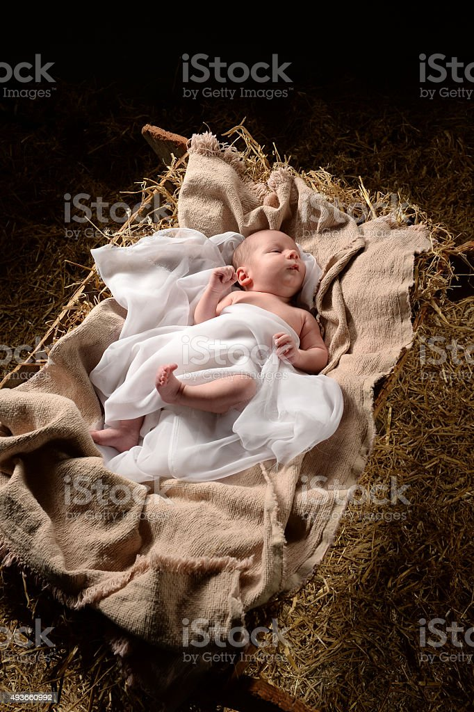 Baby Jesus on a Manger stock photo