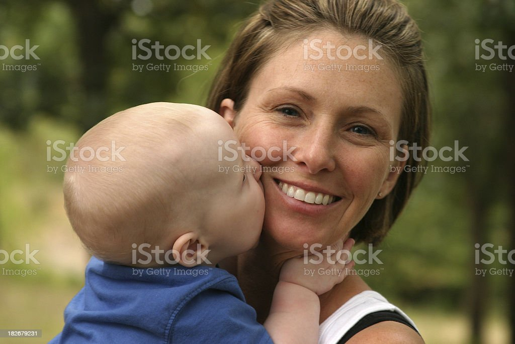 Baby Kissing Smiling Mother royalty-free stock photo