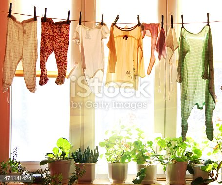 istock Baby laundry hanging on a clothesline 471141424