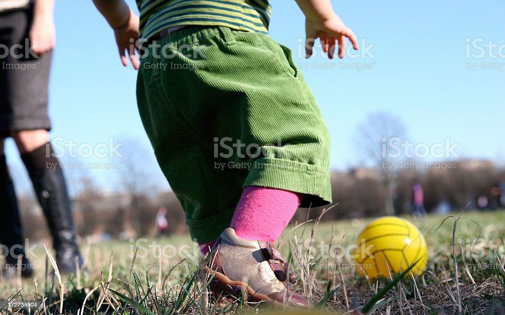 baby learning soccer stock photo