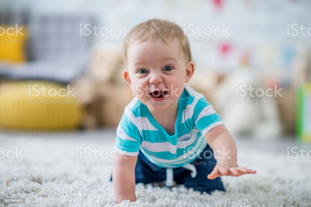 Baby Learning To Crawl stock photo