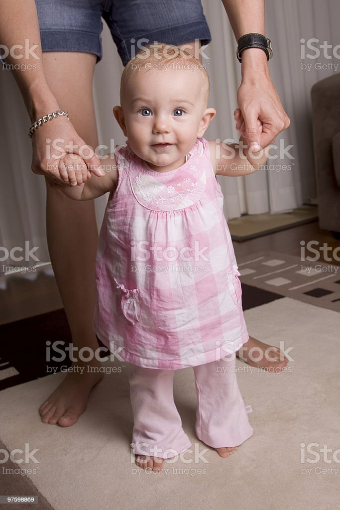 Baby learning to walk royalty-free stock photo
