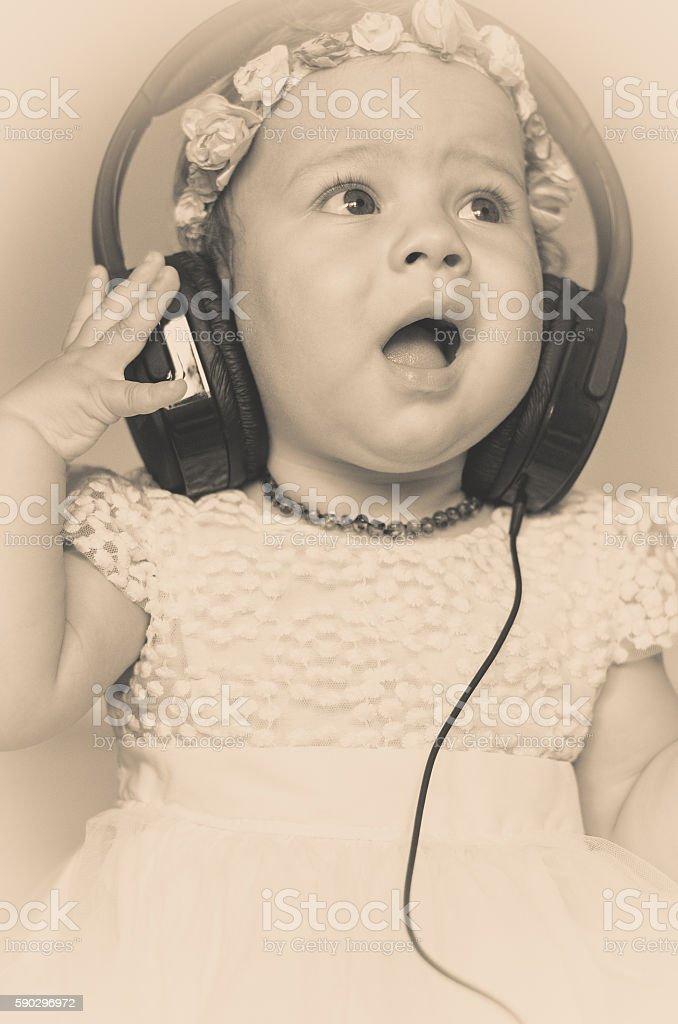 baby listening to music on headphones royaltyfri bildbanksbilder