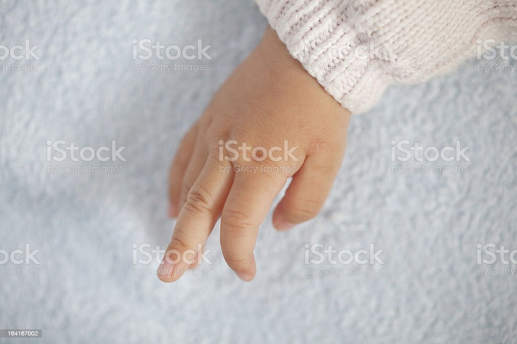 Baby little hand stretch fingers royalty-free stock photo