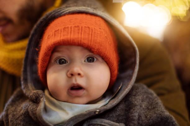 Baby looking at camera stock photo